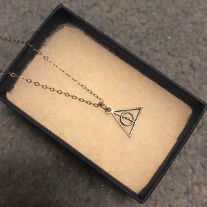 Itty bitty Harry Potter deathly hallow necklace